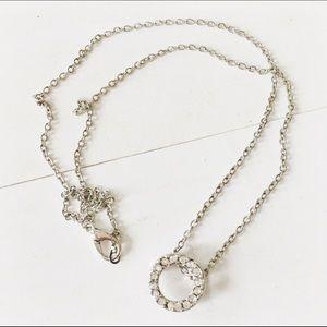 Silver toned circle rhinestone necklace